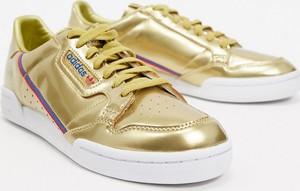 Złote buty sportowe Adidas Originals