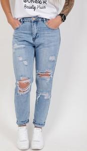 Niebieskie jeansy Olika z jeansu w street stylu