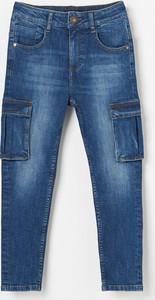 Granatowe jeansy dziecięce Reserved