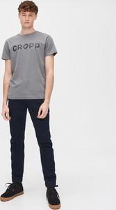 Granatowe jeansy Cropp