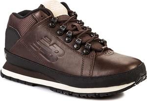 Brązowe buty sportowe New Balance w sportowym stylu