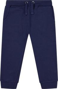 Granatowe spodnie dziecięce Guess