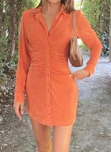 Pomarańczowa sukienka Arilook z dekoltem w kształcie litery v