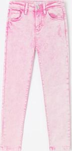 Różowe jeansy dziecięce Reserved