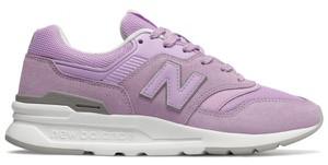 Różowe buty sportowe New Balance sznurowane z zamszu z płaską podeszwą