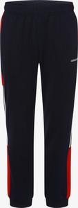 Niebieskie spodnie sportowe Adidas Originals z dresówki w sportowym stylu
