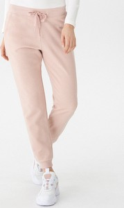 Różowe spodnie House z dresówki w młodzieżowym stylu