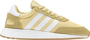 Żółte buty sportowe Adidas sznurowane z płaską podeszwą