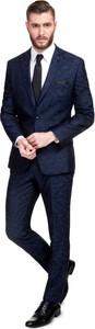 Granatowy garnitur giacomo conti z wełny