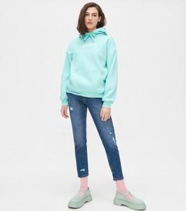 Turkusowe jeansy Cropp