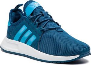 Niebieskie buty sportowe Adidas ze skóry ekologicznej w sportowym stylu sznurowane
