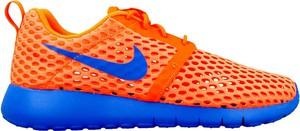 Pomarańczowe buty sportowe dziecięce Nike sznurowane