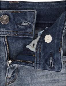 Niebieskie jeansy G- Star Raw w street stylu