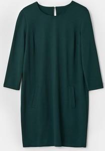Zielona sukienka Mohito oversize z długim rękawem