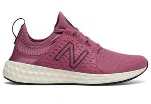 Czerwone buty New Balance w sportowym stylu