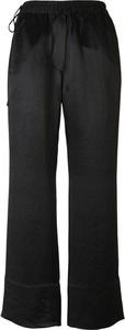 Spodnie Acne z satyny
