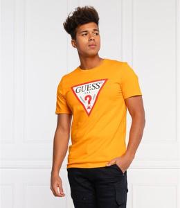Żółty t-shirt Guess z bawełny z krótkim rękawem w młodzieżowym stylu