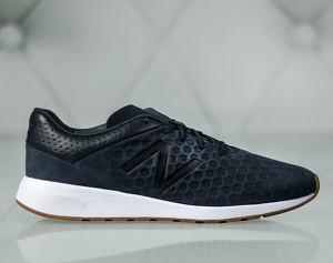 Granatowe buty sportowe New Balance w sportowym stylu sznurowane
