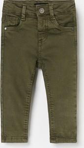 Zielone jeansy dziecięce Reserved