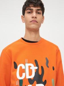 Pomarańczowa bluza Cropp z nadrukiem