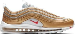 Żółte buty sportowe Nike z tkaniny w sportowym stylu