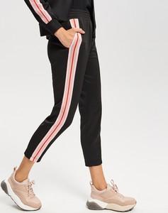 Czarne spodnie sportowe Reserved w młodzieżowym stylu
