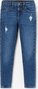 Niebieskie jeansy dziecięce Reserved
