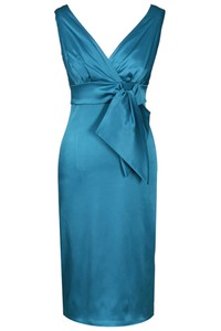 Turkusowa sukienka Fokus midi z krótkim rękawem kopertowa