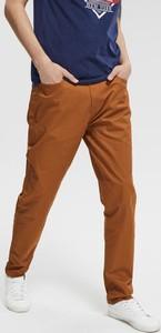 Pomarańczowe spodnie Diverse