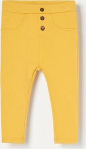 Żółte legginsy dziecięce Reserved dla dziewczynek