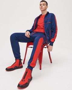 Granatowe spodnie sportowe Cropp