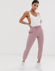Fioletowe spodnie Asos z dresówki