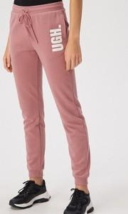 Różowe spodnie Sinsay w sportowym stylu