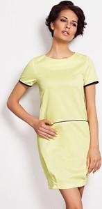 Żółta sukienka sukienki.pl w sportowym stylu z tkaniny