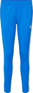 Niebieskie spodnie Adidas Originals w sportowym stylu