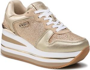 Złote buty sportowe Guess ze skóry w sportowym stylu na platformie