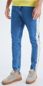 Niebieskie jeansy Cropp z jeansu