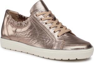 Złote buty sportowe Caprice sznurowane z płaską podeszwą