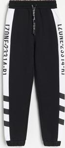 Czarne spodnie dziecięce Reserved dla chłopców