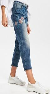 Niebieskie jeansy Reserved w street stylu z jeansu