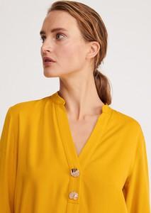 Żółta bluzka Reserved bez rękawów z dekoltem w kształcie litery v