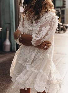 Sukienka Sandbella mini z długim rękawem