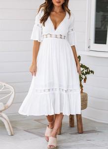 Sukienka Sandbella w stylu boho midi z długim rękawem