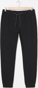 Czarne spodnie House z bawełny