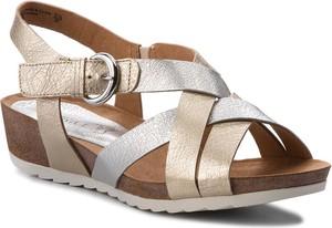Złote sandały caprice