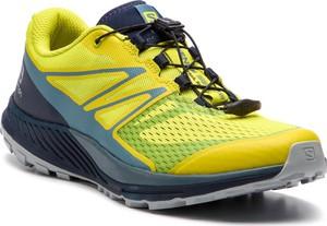 Żółte buty sportowe Salomon sznurowane