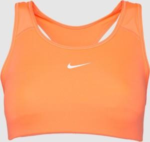 Pomarańczowa bluzka Nike w sportowym stylu z okrągłym dekoltem