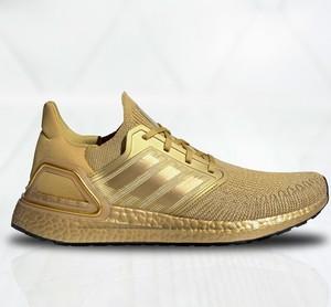 Złote buty sportowe Adidas sznurowane