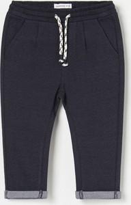 Granatowe spodnie dziecięce Reserved dla chłopców
