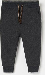 Czarne spodnie dziecięce Reserved